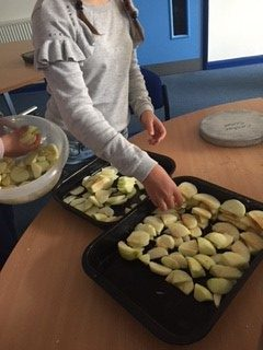 Raw apple chunks on baking tray