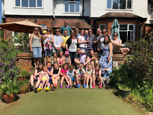 Family photo in front of house